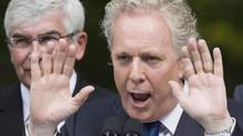 Quebec Liberal Leader Jean Charest responds to questions at a news conference while campaigning Aug. 27, 2012 in Quebec City. (Jacques Boissinot/THE CANADIAN PRESS)