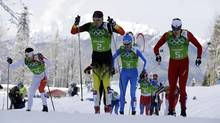 From left, Canada's Alex Harvey, Germany's Tim Tscharnke, Italy's Dietmar Noeckler and Switzerland's Gianluca Cologna ski during the cross-country team sprint competitions at the 2014 Winter Olympics, Wednesday, Feb. 19, 2014, in Krasnaya Polyana, Russia. (Lee Jin-man/AP)