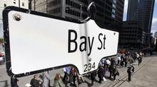 The Bay Street sign is shown in the heart of the financial district as people walk by in Toronto, May 22, 2008. (MARK BLINCH/REUTERS)