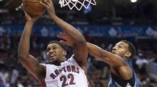 Toronto Raptors forward Rudy Gay, left, drives past Minnesota Timberwolves Derrick Williams, right, during first half NBA pre-season basketball action in Toronto on Wednesday, Oct. 9, 2013. (NATHAN DENNETTE/THE CANADIAN PRESS)