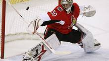 Ottawa Senators goaltender Brian Elliott makes a stick save during second period NHL hockey action against the Buffalo Sabres in Ottawa on Dec. 16, 2009. (Fred Chartrand)