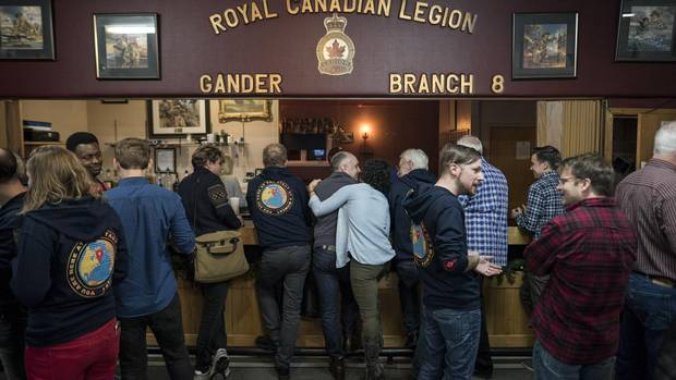 Members of the cast and crew of Come From Away gather with locals at the Legion in Gander, N.L. on Oct. 30.