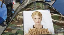 A man walks past tents for supporters of jailed opposition leader Yulia Tymoshenko in Lviv May 4, 2012. (GLEB GARANICH/REUTERS)