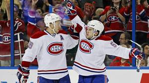 Montreal Canadiens' David Desharnais, right, celebrates a goal with teammate Josh Gorges during the first period of an NHL hockey game in Tampa, Florida February 28, 2012.