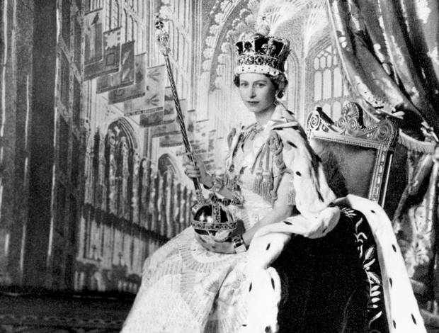 Queen Elizabeth II is shown in Buckingham Palace's Throne Room after her coronation on June 2, 1953.