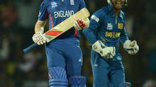England's Eoin Morgan reacts after being dismissed as Sri Lanka's Kumar Sangakkara (R) celebrates during the Twenty20 World Cup Super 8 cricket match in Pallekele October 1, 2012. (PHILIP BROWN/REUTERS)