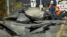 A large sinkhole closed a section of Bayview Avenue just north of Steeles Avenue as crews worked to repair the damage in Toronto, Ont. Nov. 3, 2011. (Kevin Van Paassen/Kevin Van Paassen/The Globe and Mail)