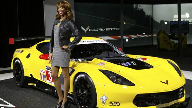 Model and product specialist Alicia Amie poses next to the Chevrolet C7.R Corvette Stingray during the press preview day of the North American International Auto Show in Detroit, Michigan January 14, 2014. (REBECCA COOK/REUTERS)