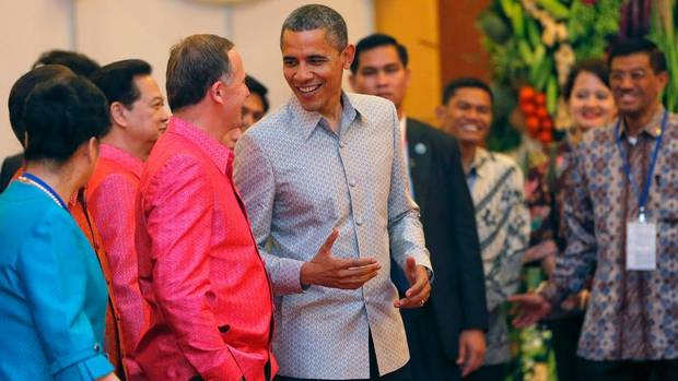 U.S. President Barack Obama (C) talks to New Zealand Prime Minister John Key as they arrive for the gala dinner together with other head of states participating in the 21st ASEAN (Association of Southeast Asian Nations) and East Asia summits in Phnom Penh November 19, 2012. (DAMIR SAGOLJ/Reuters)