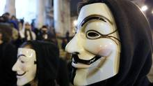 "A protester wearing a Guy Fawkes mask, symbolic of the hacktivist group ""Anonymous"", takes part in a protest in central Brussels January 28, 2012. (YVES HERMAN/Yves Herman/Reuters)"