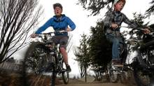 Nathaniel Cook,16, left, and his friend Matthew Brown,12, ride the pump track at the Cecelia Ravine bike park, a continuous loop that can be ridden without peddling. The park is the first of its kind in Victoria,BC, which features three separate skill level trails and a variety of technical terrain. (Chad Hipolito for The Globe and Mail/Chad Hipolito for The Globe and Mail)