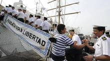 Replacement crew of the Argentine naval tall ship ARA Libertad board the ship at Tema harbour in Accra, Dec. 19, 2012. The Argentine naval vessel, detained in Ghana at the request of a hedge fund seeking payment on defaulted government bonds, left the West African country on Wednesday, a port official said. (REUTERS)