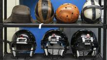 In this Sept. 23, 2010, file photo some football helmets used for testing helmet-to-helmet collisions are seen in a rack at a laboratory in the Cleveland Clinic's Lutheran Hospital. Sen. Tom Udall, D-N.M., and Rep. Bill Pascrell, D-N.J., introduced the Children's Sports Athletic Equipment Safety Act in March 2011. With sports concussions among the nation's young people a big issue in schools the bill would give the industry nine months to come up with new standards that address concussion risks and their specific needs. (AP Photo/Mark Duncan, File) (Mark Duncan/AP)