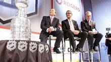 NHL Commissioner Gary Bettman (left), Rogers Communications CEO Nadir Mohamed and Rogers Media President Keith Pelley during a conference announcing a 12-year national broadcast and multimedia agreement between Rogers Communications and the NHL in Toronto, Nov. 26, 2013. (Fernando Morales/The Globe and Mail)