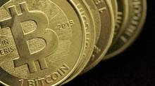 Bitcoins are pictured in this photo illustration. (Jim Urquhart/Reuters)