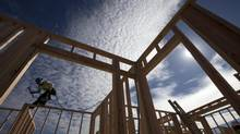 In this Nov. 16, 2012 file photo, construction worker Elabert Salazar works on a house frame for a new home in Chula Vista, Calif. (Gregory Bull/AP)