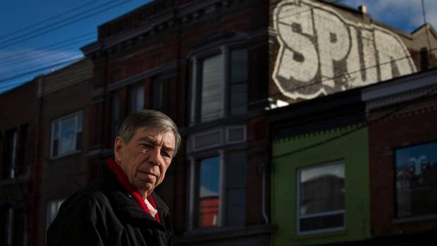 Phillip Carter, principal at Phillip Carter Architect on Queen Street West in Toronto, was heartbroken to find graffiti defacing a wall of the heritage building that houses his office. But he's philosophical. 'Police have better things to do than catch guys on roofs with spray cans.' (Galit Rodan for the Globe and Mail)