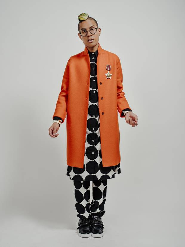 Kassam wears a coat by Harris Wharf of London over a shirt and trousers by Marimekko. His eyeglasses are Céline, his sneakers are Michael Kors, and his Bulgarian medal is a vintage heirloom.