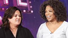 "In this Oct. 10, 2011, file image released by Harpo, Inc., Oprah Winfrey, right, is shown with host Rosie O'Donnell during the debut of ""The Rosie Show,"" in Chicago. (George Burns/2011 Harpo Productions, INC.)"