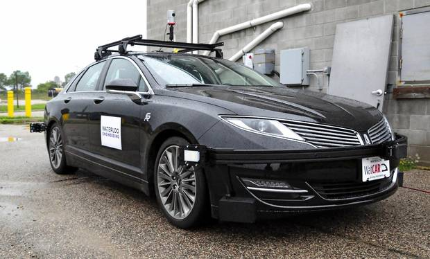 The Waterloo Centre for Autonomous Research self-driving car sits idle on a test road near the University of Waterloo campus in September, 2016.