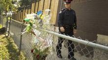 Toronto Police Sgt. Chris Laush, one of two officers now completely dedicated to working with the Somali community in 23 Division in Toronto, shows some of the division's more troubled spots on Oct. 4, 2012. He's in the Jamestown area where two men from the Somali community were recently shot to death. Faded flowers from a memorial mark the area nearby. (Peter Power/The Globe and Mail)
