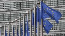 EU flags fly at the European Commission headquarters in Brussels in this file photo from 2011. (Yves Logghe/Associated Press)