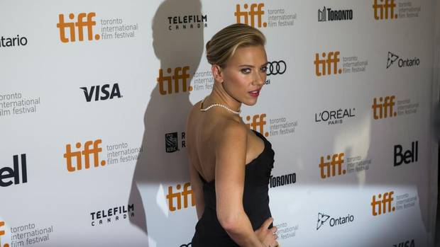 "Scarlett Johansson poses for a photograph on the red carpet at the gala for the new movie ""Don Jon"" during the 2013 Toronto International Film Festival in Toronto on TuesdaySept. 10, 2013. (Chris Young/The Canadian Press)"