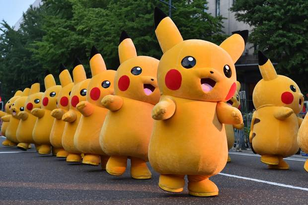 (FILES) This file picture taken on August 2, 2015 shows costumed performers dressed as Pikachu, the popular animation Pokemon series character, attending a promotional event at the Yokohama Dance Parade in Yokohama.