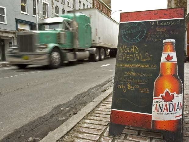 A truck passes a sign advertising Molson beer in Halifax.
