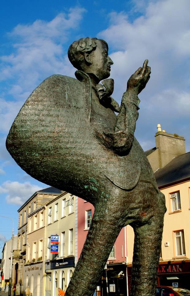 A statue of Yeats overlooks a street in Sligo.