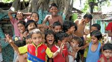 Image of children in India from the documentary Happy.