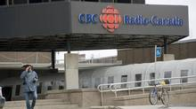 A man walks towards the CBC/Radio-Canada building in Montreal, Wednesday, April 4, 2012. (Graham Hughes/THE CANADIAN PRESS)