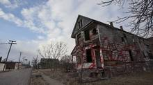 A lone vacant graffiti covered house sits in an area that used to be filled with houses in Detroit's east end on March 20, 2013. Over years of decline, many homeowners have lost their homes and they have been torn down if they become uninhabitable. (Deborah Baic/The Globe and Mail)