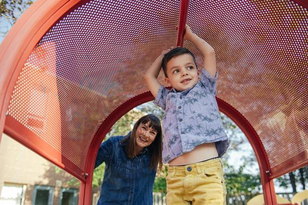 Tonia Krauser and her son Bodhi, 5, spend time in the playground behind Clinton Street Junior Public School on Aug. 26. Krauser is worried about Bodhi's class size.