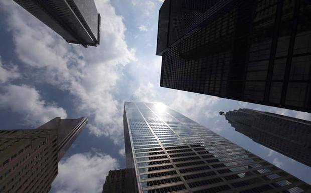 Bank towers are shown from Bay Street in Toronto's financial district in this file photo. A recent survey asked corporate leaders about interest rates, minimum-wage increases, manufacturing, trade policy and the Trump