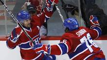 Montreal Canadiens' Brian Gionta (L) celebrates his goal on the Philadelphia Flyers with teammate P.K. Subban during the third period in Game 3 of their NHL Eastern Conference final hockey series in Montreal, May 20, 2010. (SHAUN BEST/REUTERS)