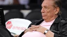 In this Oct. 17, 2010 file photo, Los Angeles Clippers team owner Donald Sterling watches his team play in Los Angeles. (Mark J. Terrill/THE ASSOCIATED PRESS)