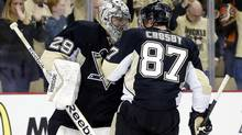 Pittsburgh Penguins goalie Marc-Andre Fleury and centre Sidney Crosby celebrate after defeating the Columbus Blue Jackets in game one of the first round of the 2014 Stanley Cup Playoffs at the CONSOL Energy Center. (Charles LeClaire/USA Today Sports)