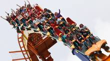 Riders enjoy the Behemoth - Canada's largest, longest, fastest and most terrifying roller coaster - at Canada's Wonderland in Toronto. (Tory Zimmerman/The Globe and Mail)