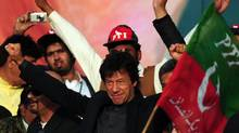 Pakistani former cricketer turned politician Imran Khan, waves to supporters during a public meeting in Karachi on December 25, 2011. (ASIF HASSAN/AFP/Getty Images/ASIF HASSAN/AFP/Getty Images)