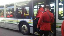 Mounties board a bus in Moncton on June 10, 2014, before funeral services for three RCMP officers slain in shootings the week before. (KATHRYN BLAZE CARLSON/THE GLOBE AND MAIL)