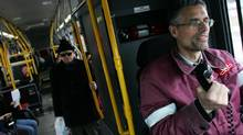 TTC bus driver Richard Smith announces the stops on the Finch Avenue West bus route in Toronto, Jan. 28, 2008. (Jim Ross for The Globe and Mail)