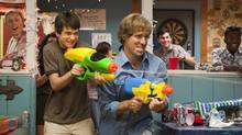 Liam James, left, and Nat Faxon in a scene from The Way Way Back. (Claire Folger/AP)