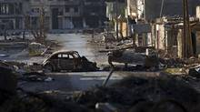 Destroyed cars and buildings are seen in the besieged city of Misrata, Libya, April 28, 2011. (Bernat Armangue/AP/Bernat Armangue/AP)