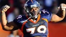 Denver Broncos defensive tackle Marcus Thomas (79) reacts to a tackle during the second quarter of the game against the Kansas City Chiefs at Sports Authority Field. Mandatory Credit: Ron Chenoy-US PRESSWIRE (Ron Chenoy/US PRESSWIRE)