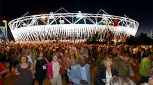 In this Monday July 23, 2012 file photo, crowds leave the Olympic Stadium at the Olympic Park in London, following the dress rehearsal for the Opening Ceremony for the 2012 Olympic Games. (John Giles/AP)