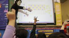 Monica Fong from David Livingstone Elementary works on a SMART board in class in Vancouver, BC, Feb. 29, 2008. (Lyle Stafford for The Globe and Mail/Lyle Stafford for The Globe and Mail)