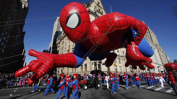 The Spider-Man balloon floats down Central Park West during the 87th Macy's Thanksgiving Day Parade in New York. When the parade began in 1924, it was called the Macy's Christmas Parade and featured live animals from the Central Park Zoo marching along with Macy's employees. (GARY HERSHORN/REUTERS)