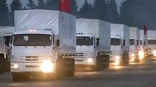 A convoy of white trucks leaves Alabino, outside Moscow, on Aug. 12, 2014, for a humanitarian relief mission to eastern Ukraine. (RTR VIA ASSOCIATED PRESS TELEVISION/ASSOCIATED PRESS)