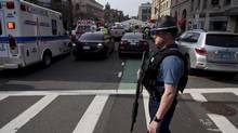 A Massachusetts State Police officer stands guard at the scene after explosions reportedly interrupted the running of the 117th Boston Marathon in Boston, Massachusetts April 15, 2013. (DOMINICK REUTER/Reuters)